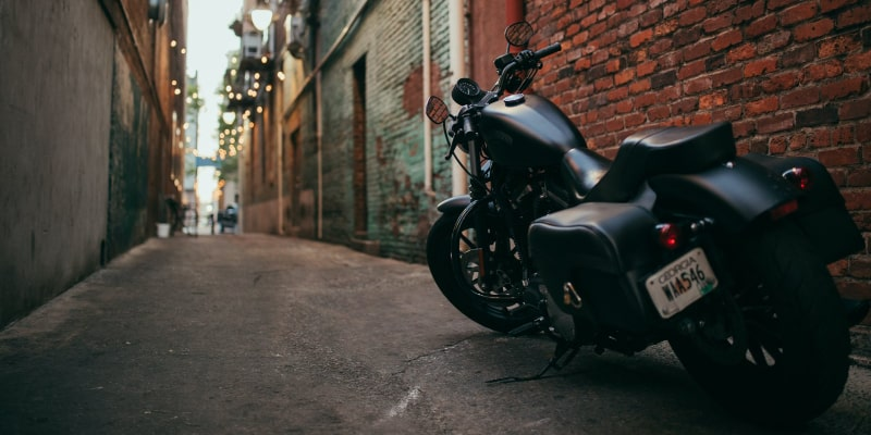Motorcycle parked in an alleyway