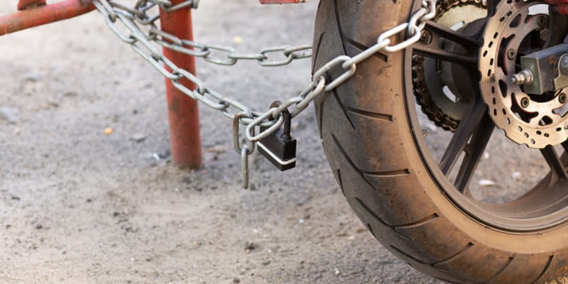 Parked motorcycle secured with lock and chain