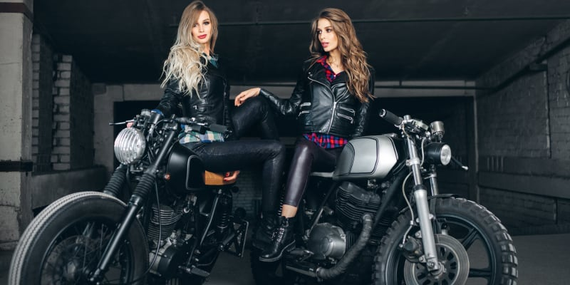 Women on their motorcycle wearing rider's boots