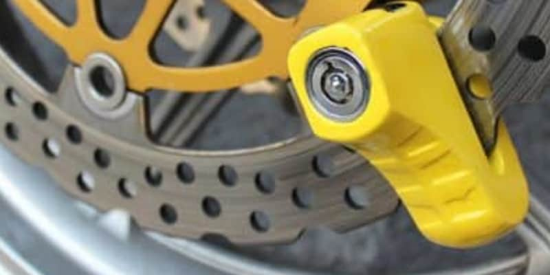Yellow disc lock on motorcycle