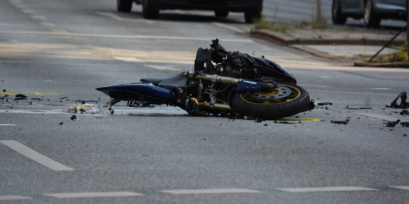 Damaged motorcycle lying on a street