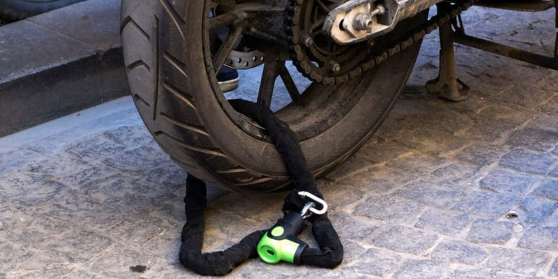Motorcycle secured with lock and chain