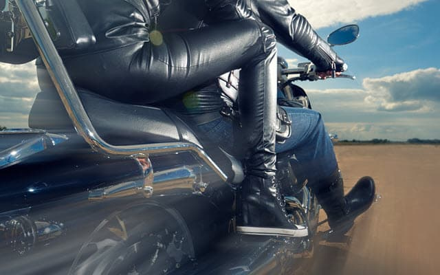 Woman wearing leather motorcycle pants