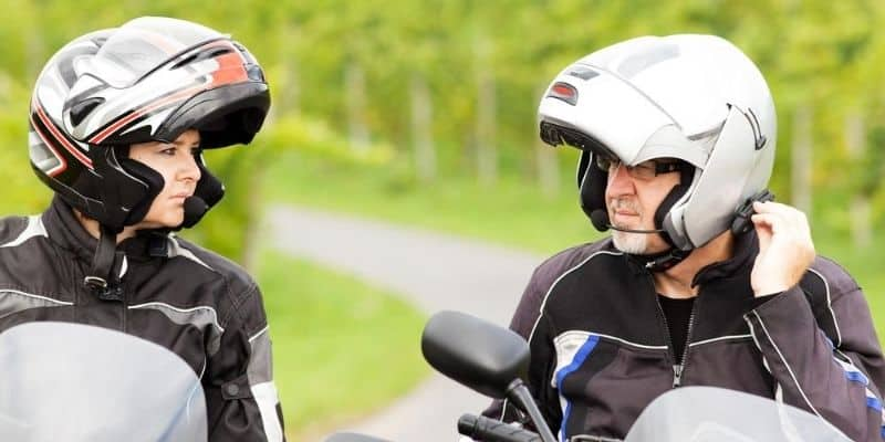 Two motorcycle riders using a motorcycle communication system