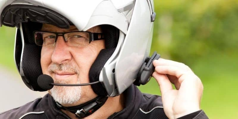 Motorcycle rider with headset in helmet