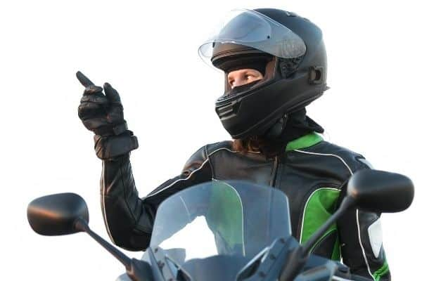 Woman wearing black and green leather jacket and helmet