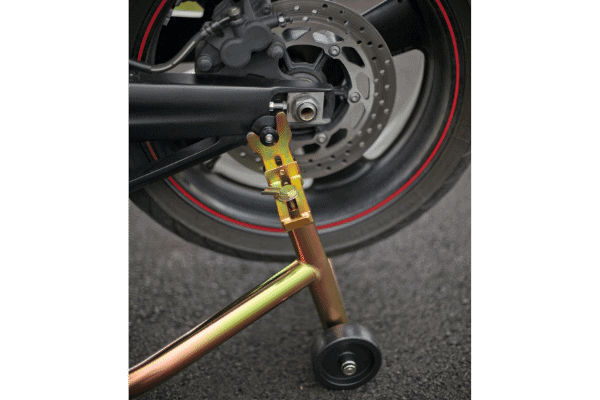 Black and gold paddock stand used on motorcycle