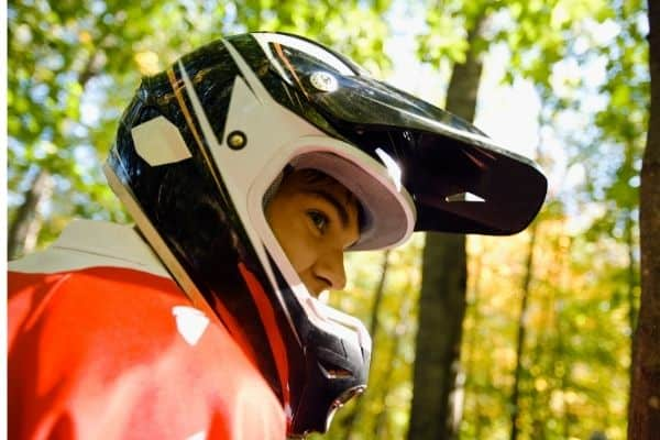Rider wearing dirt bike helmet