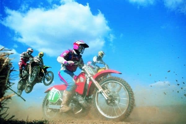 Group of people riding dirt bike