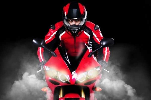 Red and black motorcycle and gear