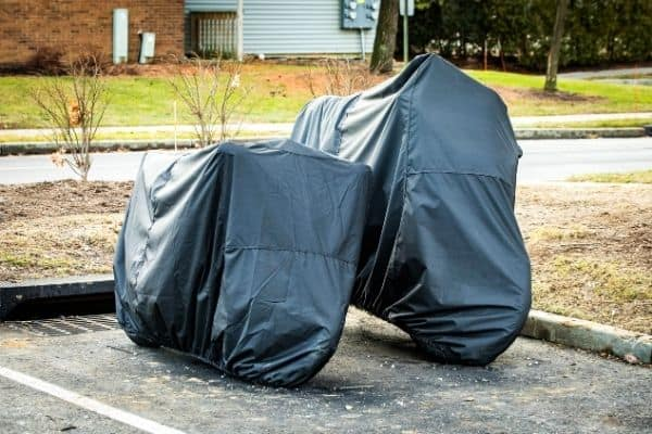 motorcycle parked outside with black waterpoof motorcycle covers