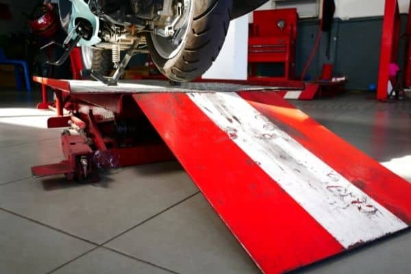 red and white motorcycle lift table