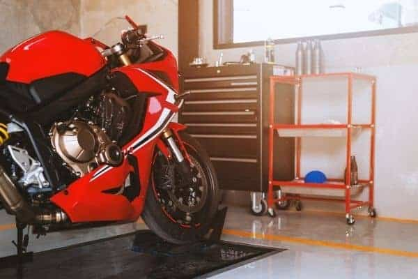 red sports bike on hydraulic lift table