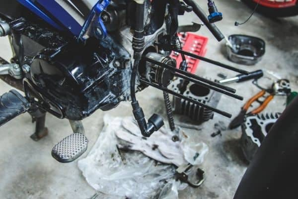 Fixing motorcycle with tools