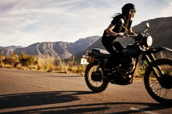 woman riding an off-road motorcycle