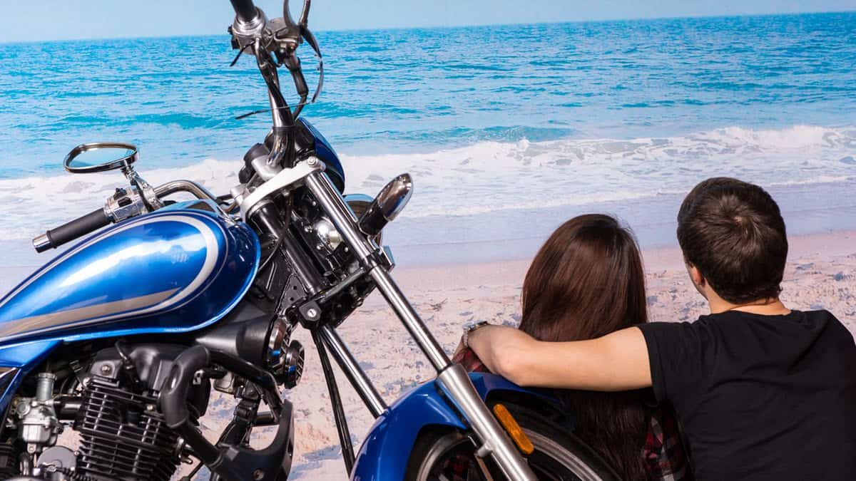 Couple on a motorcycle date at the beach