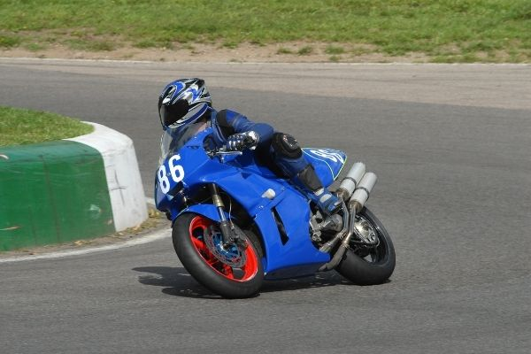 person riding a bike with blue motorcycle fairing