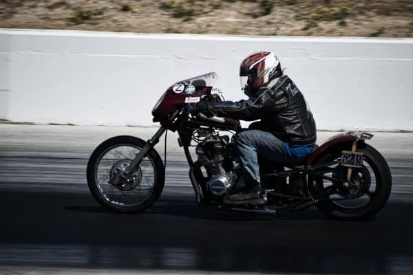 person riding a motorcycle on the highway