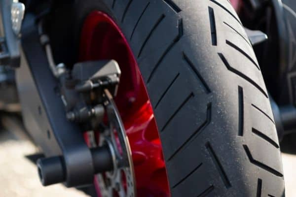 fat motorcycle tire with red rims