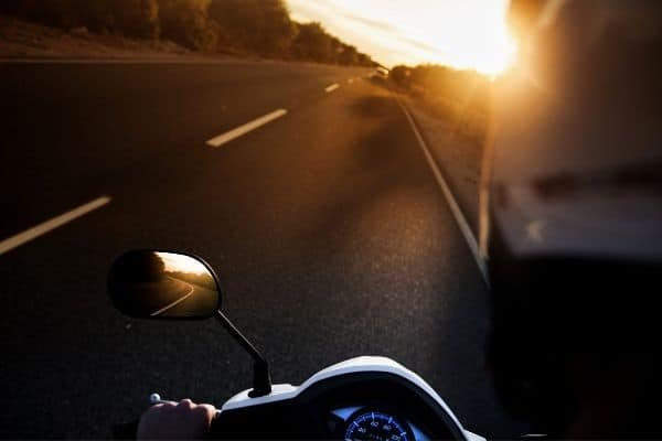 riding motorcycle early in the morning