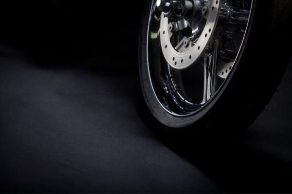 motorcycle tire on black background