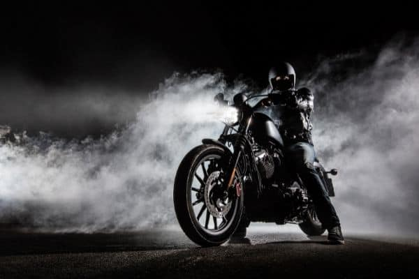 person on a black matte motorcycle