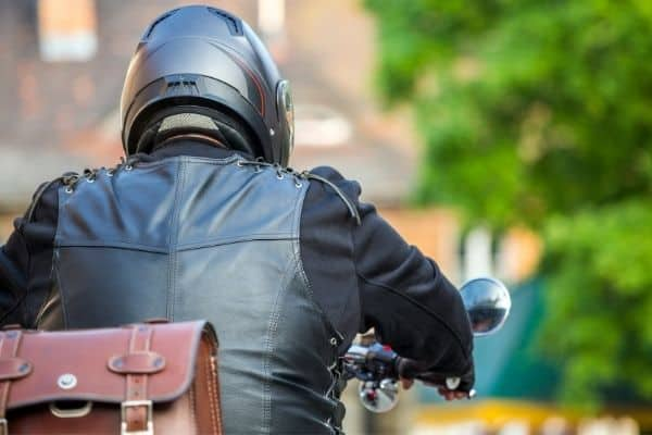 a motorcycle rider from behind