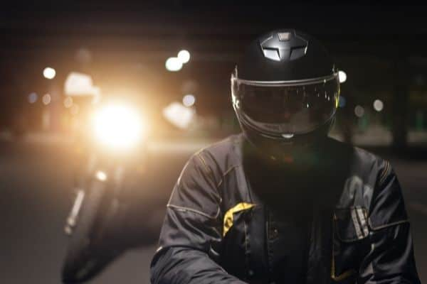 motorcycle rider in a black jacket and a helmet